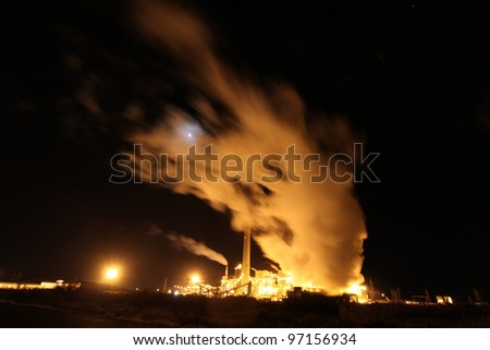 Steam Plant New Mexico/Long view of power plant off US 40 in New Mexico with lights & steam billowing into the night air.