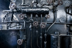 Steam punk black old metal background. Background of engine room detail of a steam locomotive