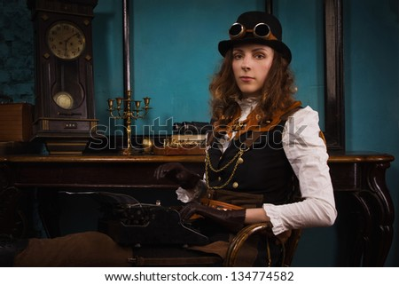 Steam punk girl and old typewriter in a vintage room