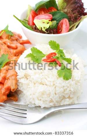 Steam rice with Butter Chicken and salad in the background