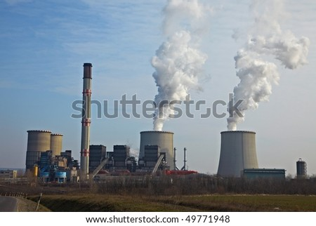 Steam rising from the cooling towers of a power station