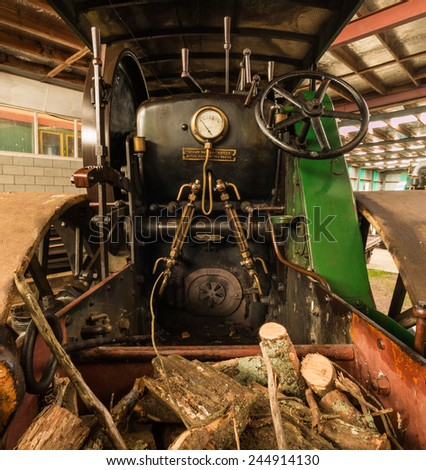 Steam Roller cab with fire wood in it really to go.