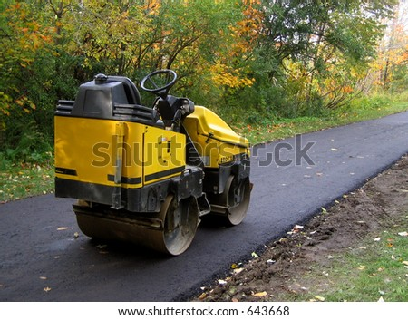 steam roller on freshly paved path
