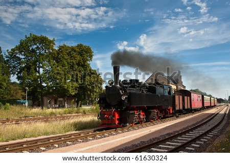 Steam Train Leaving a Station