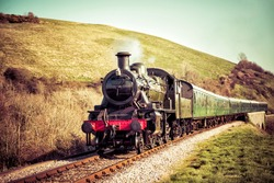 Steam Train Locomotive traveling in the Countryside