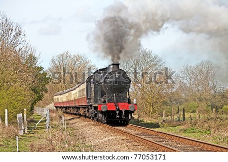Steam train on a gentle day out with passengers on-board