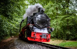 Steam train on railroad ride. Locomotive. Steam train