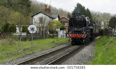 Steam train passing level crossing in yorkshire