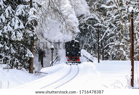 Steam train ride in winter forest snow. Locomotive steam train ride in winter forest. Winter forest steam train ride