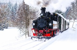 Steam train ride in winter snow travel scene