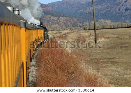 Steam Train Rolling Through Landscape