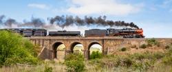 Steam Train Travelling over an Old Bluestone Bridge, Sunbury, Victoria, Australia, October 2018