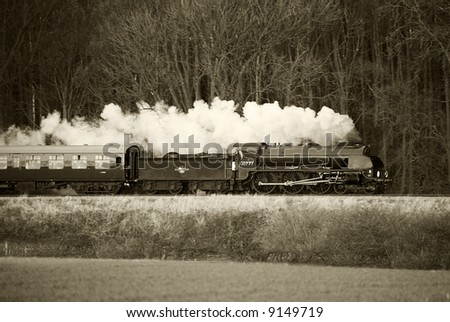 steam trains in black and white with sepia tint
