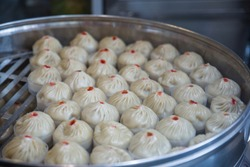 Steamed ban in aluminum basket, dim sum is most popularappetizer food for chinese in China