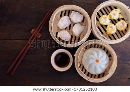 Steamed Bun and Shrimp Shumai, a steamed dish in a bamboo steamer box to enjoy the sweet tenderness of dried sakura shrimp., Name dim sum. Сток-фото ©