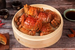 steamed chinese mitten crab, shanghai hairy crab in bamboo steamer