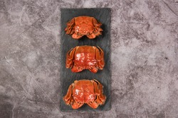 steamed chinese mitten crab, shanghai hairy crab isolated on stone background