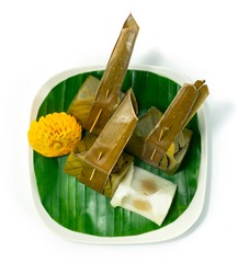 Steamed Coconut Custard with Sweet Coconut Filling Thai Dessert decorate Carved Pumpkin Flower Shape topview