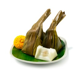 Steamed Coconut Custard with Sweet Coconut Filling Thai Dessert decorate Carved Pumpkin Flower Shape sideview