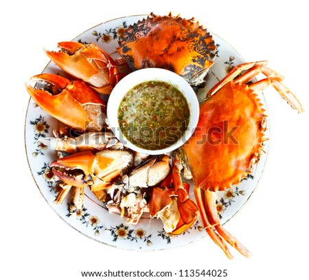steamed crabs with spicy seafood sauce in Thai style on white background