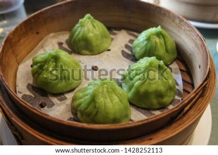 Steamed dumpling, steamed stuff bun. Popular Chinese food. #1428252113