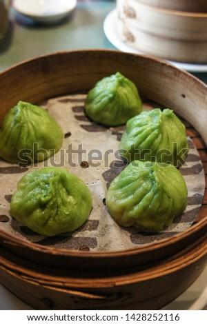 Steamed dumpling, steamed stuff bun. Popular Chinese food. #1428252116