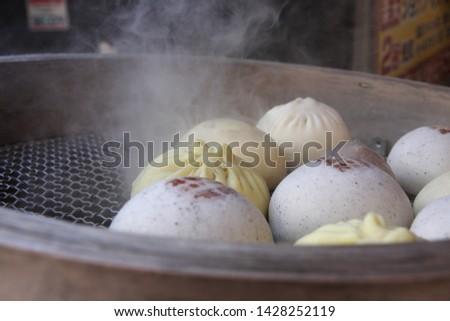 Steamed dumpling, steamed stuff bun. Popular Chinese food. #1428252119