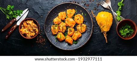 Steamed dumplings or manti with pumpkin.Kazakh manti with pumpkin.Asian manty with pumpkin
