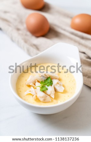 steamed egg with crab raw #1138137236
