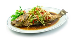 Steamed Grouper Fish with Soy Sauce Chinese food Style sideview