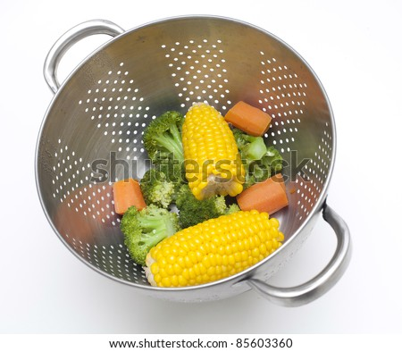 steamed healthy vegetables on white background