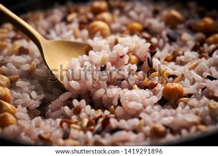 Steamed multi grain rice with spoon