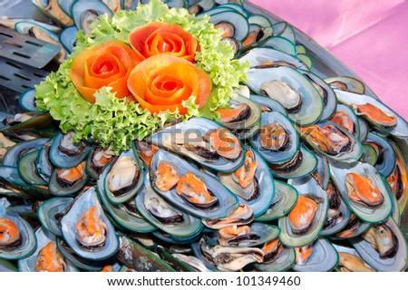 steamed mussels decorate dish with tomato rose