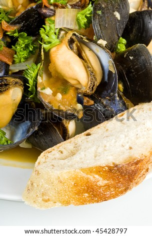 Steamed Mussels Served with a Slice of Baguette