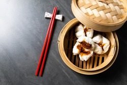 steamed pork bun. Chinese Traditional cuisine concept. Dumplings Dim Sum in bamboo steamer with text copy space. Asian food background