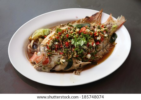 Steamed sea bass with lemon on plate