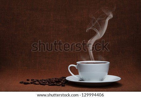 steaming coffee with beans and copy space