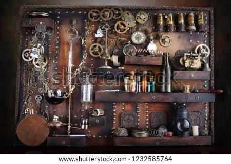 Steampunk distiller with ancient gears  #1232585764