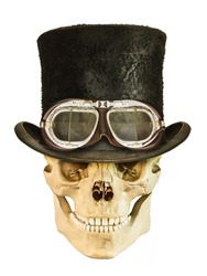 Steampunk smiling skull with vintage hat and leather goggles isolated on a white background