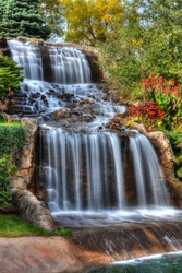 Steams of misty water fall down the hill in High Dynamic Range