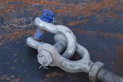 Steel anchor shackle on steel plate background