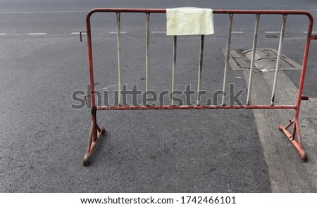 Steel barricades are laid on the road.