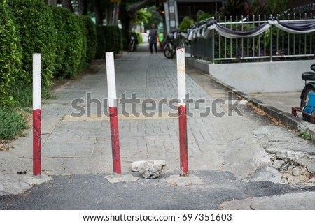 Steel barrier stop motorcycle ride on footpath #697351603