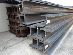 Steel beam lay on concrete floor in stack