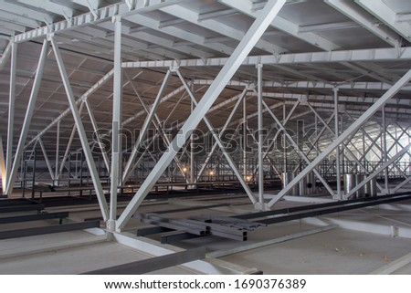 Steel beam of the new hangar roof structure. Steel frame construction