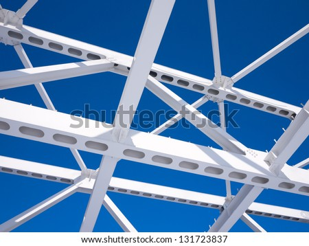 Steel beams against the blue sky Fragment construction site