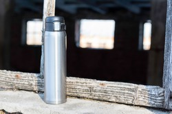 Steel bottle for saving boiling water. Thermal bottle steel. Front view.