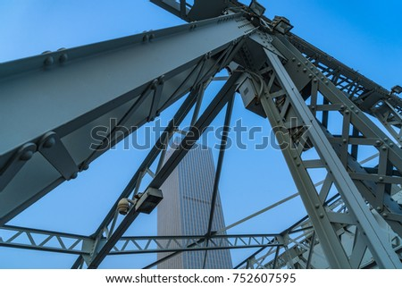 steel bridge and modern skyscrapers under blue sky #752607595