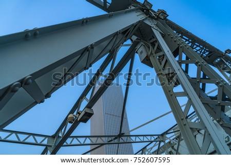 steel bridge and modern skyscrapers under blue sky #752607595