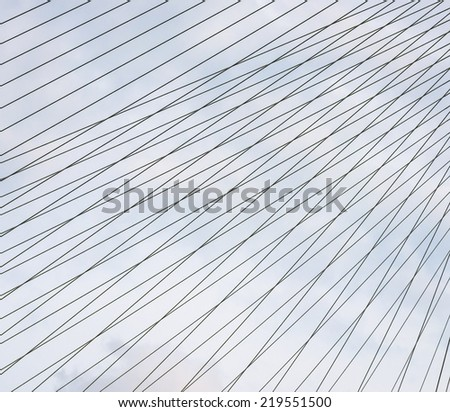 Steel cables over sky background.